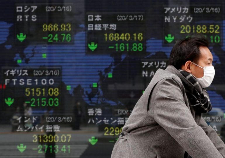 Asian shares mixed, U.S. dollar near two-and-half year lows