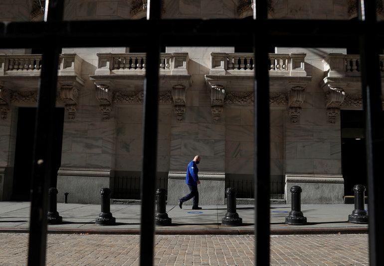 Futures slip on rising virus cases; eyes on stimulus deal