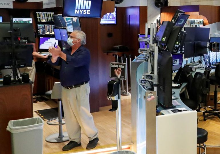 Wall Street falls at open as weekly jobless claims surge