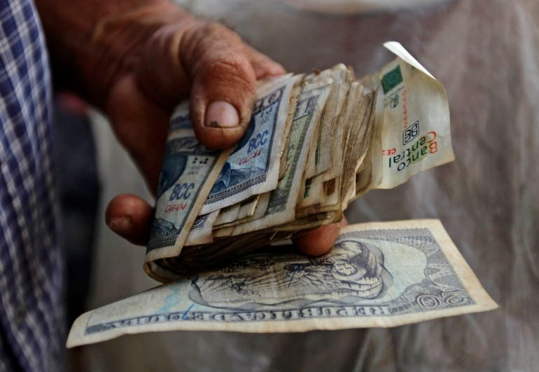 Cuba adopting single exchange rate in January, in first devaluation since revolution