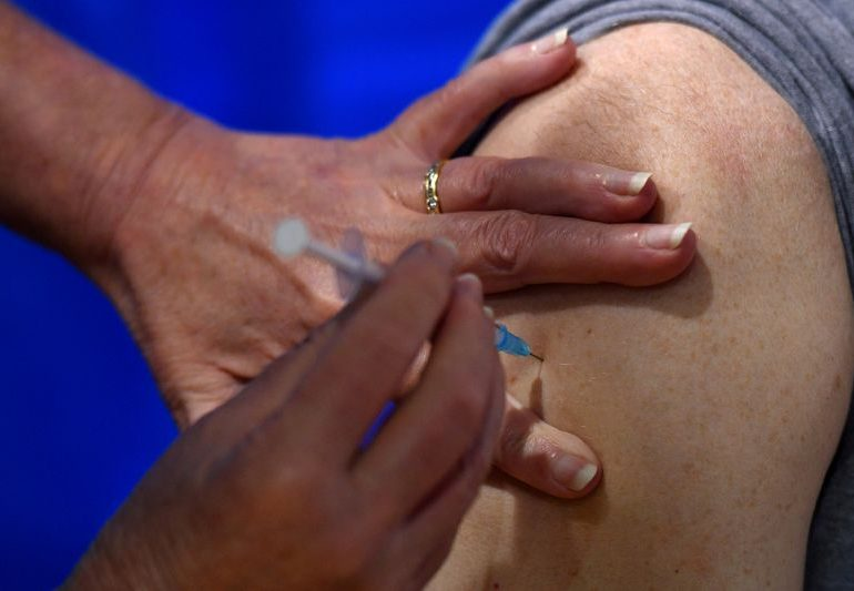 Vaccine carrots or sticks? U.S. businesses grapple with getting employees inoculated