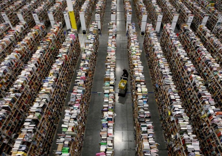 """Holiday retail workers seek """"temporary lifeline"""" in warehouse jobs, if they can find one"""