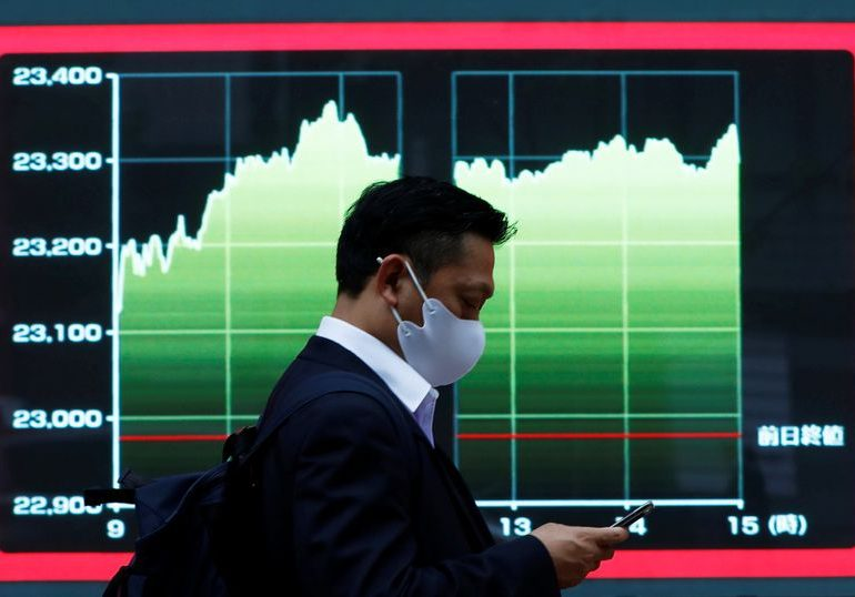 Global shares edge up as Trump signs $2.3 trillion aid bill