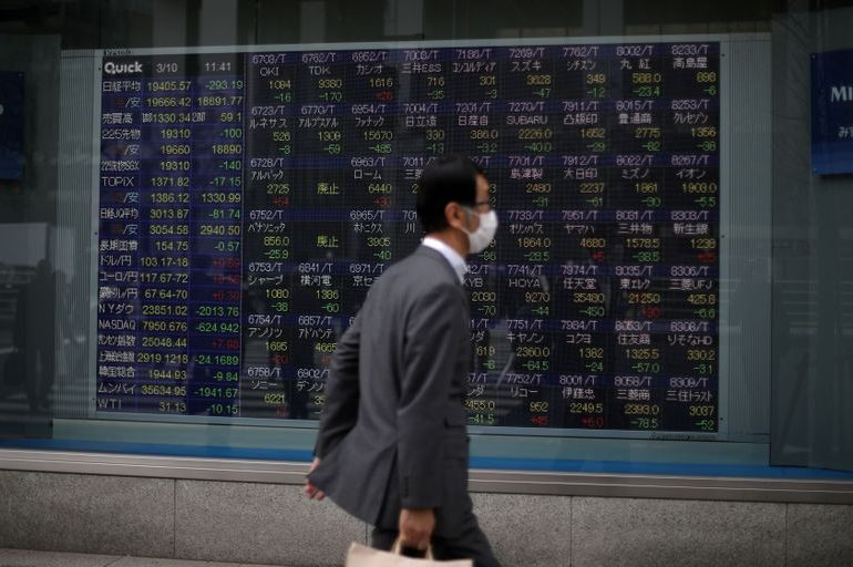 Asian shares jump on U.S. stimulus, Japan's Nikkei at 29-year high