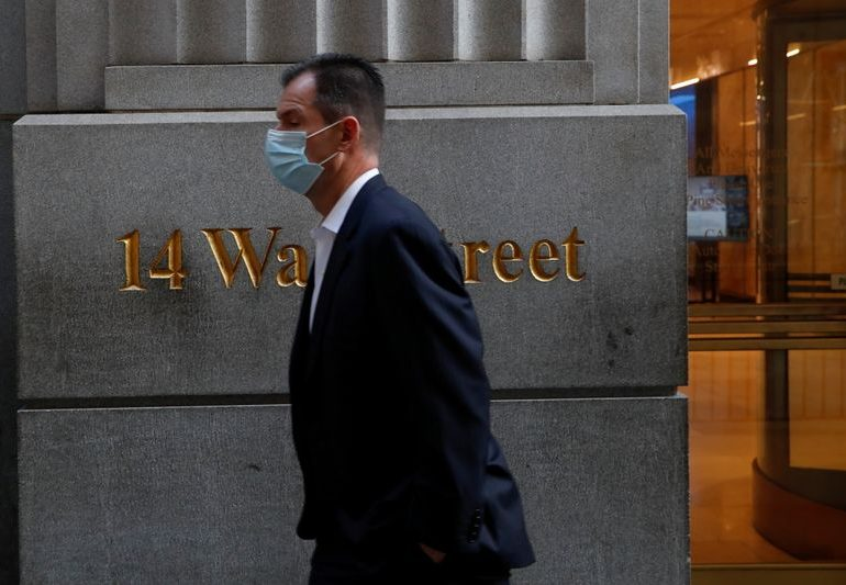 Wall St opens at record high on fiscal aid relief, vaccine optimism