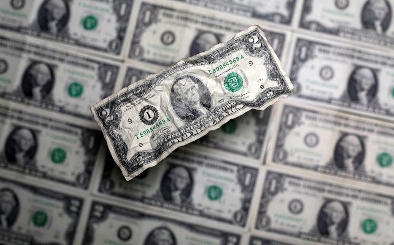 Dollar slumps as bears shrug off U.S. stimulus delay