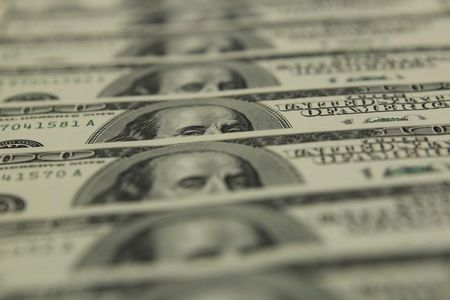 Dollar Edges Lower; Fed Retains Easy Policy Stance