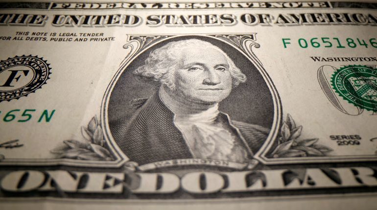 Dollar gains put on hold, sterling looks to BoE for cues