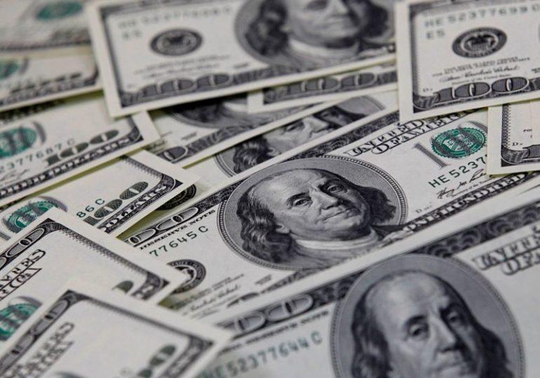 Dollar slumps as U.S. Treasury yields soften, but bitcoin eyes $50,000
