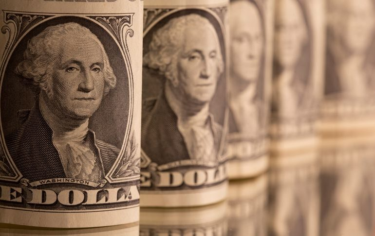 Dollar headed for weekly loss, bitcoin hits record $49,000