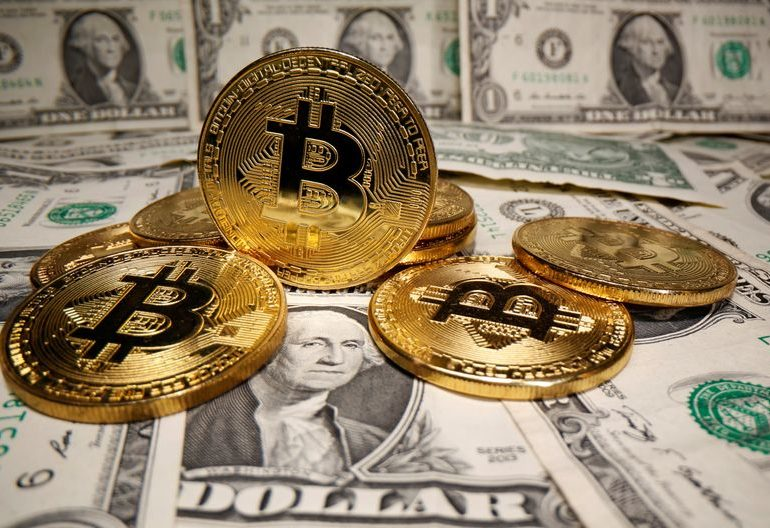 Dollar held down by doubts over pace of U.S. recovery; bitcoin retreats from record high