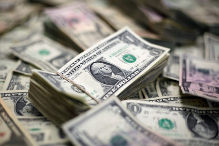 Dollar Edges Lower,  Consolidating After Week's Gains