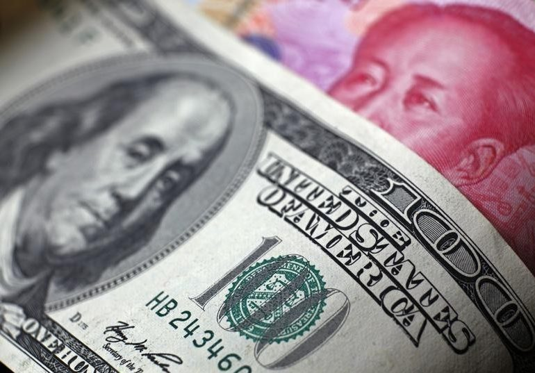 Yuan Erases Year's Gains Against Dollar as PBOC Steps Aside By Bloomberg