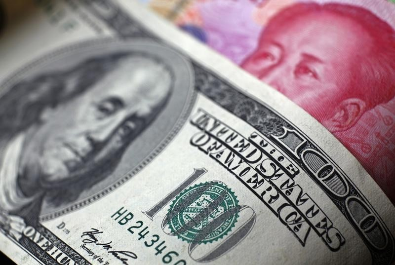 Yuan Erases Year's Gains Against Dollar as PBOC Steps Aside