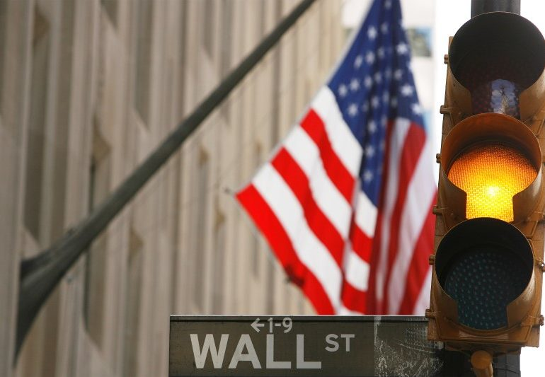 With stocks at record highs, investors look to upcoming earnings By Reuters