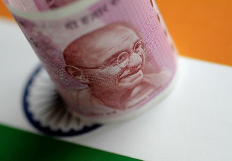 Rupee Tumbles on Worries RBI's Bond Plan May Add to Money Glut By Bloomberg
