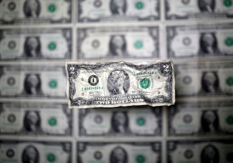 U.S. dollar to remain strong for at least another month: Reuters poll