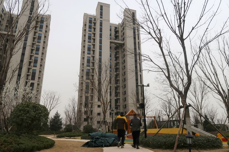 Analysis: In China's small cities, home buyers suffer as debt-ridden developers fail to finish projects