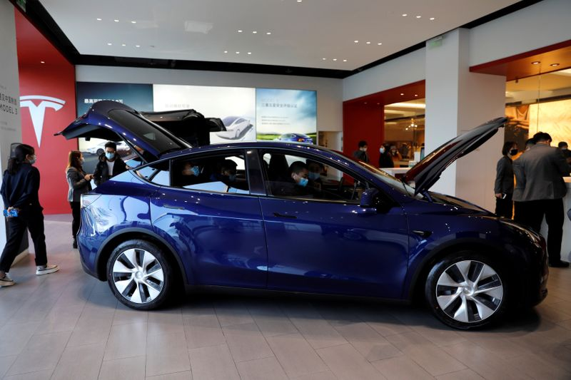Tesla shares surge on record electric cars deliveries in first quarter