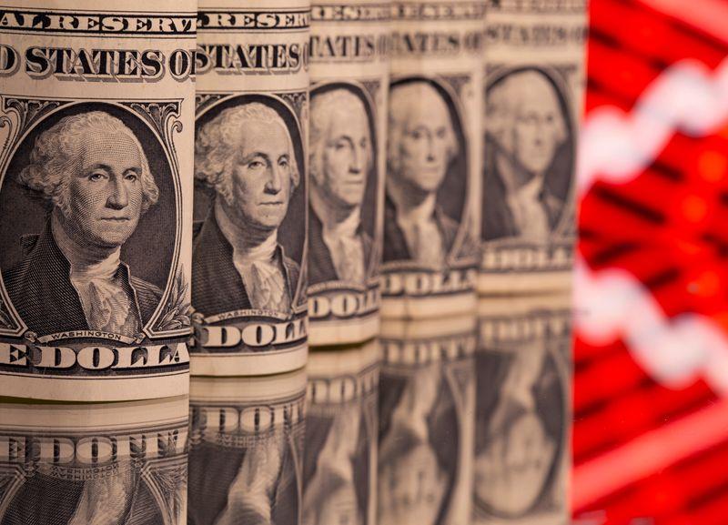 Dollar stuck near two-week lows amid lower U.S. yields