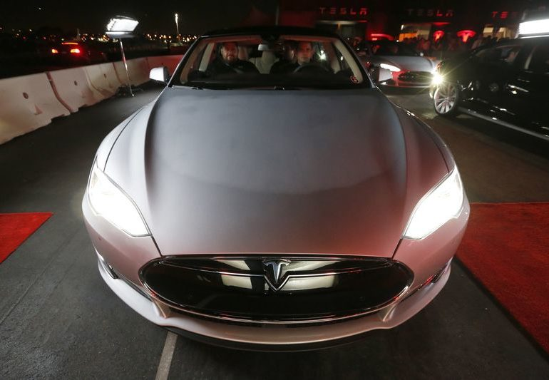 Tesla shares surge on record electric cars deliveries in first quarter By Reuters