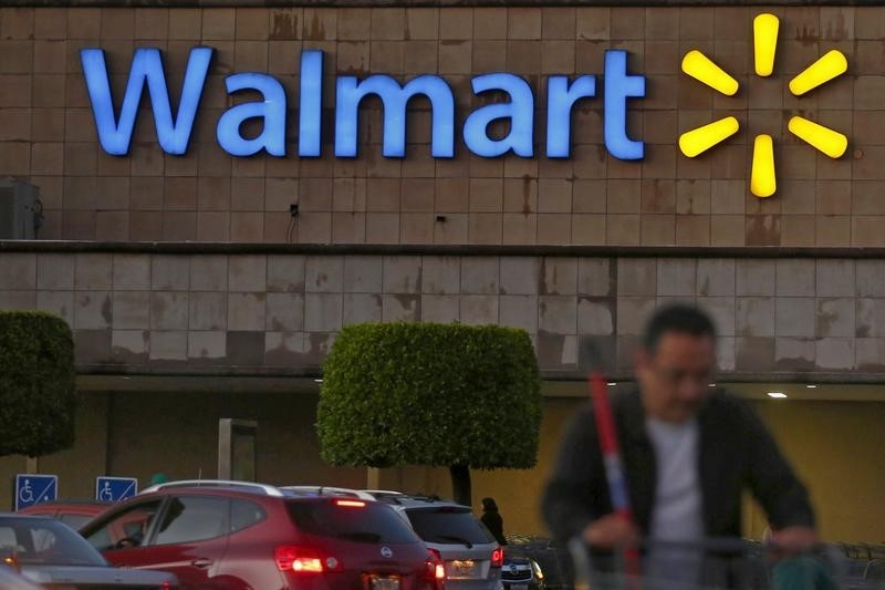 Walmart says fully vaccinated employees can go without masks starting Tuesday By Reuters