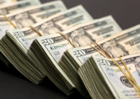 Dollar Up, Hits One-Month High as Fed Hints at Earlier-Than-Expected Rate Hike By Investing.com