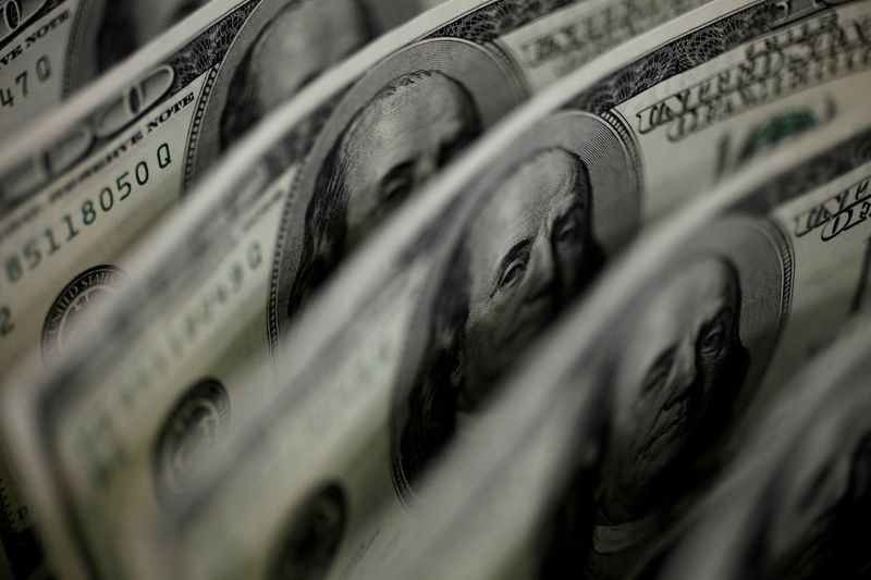 Dollar holds near one-year high amid bets for earlier Fed rate hike